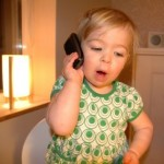 Toddler on mobile phone